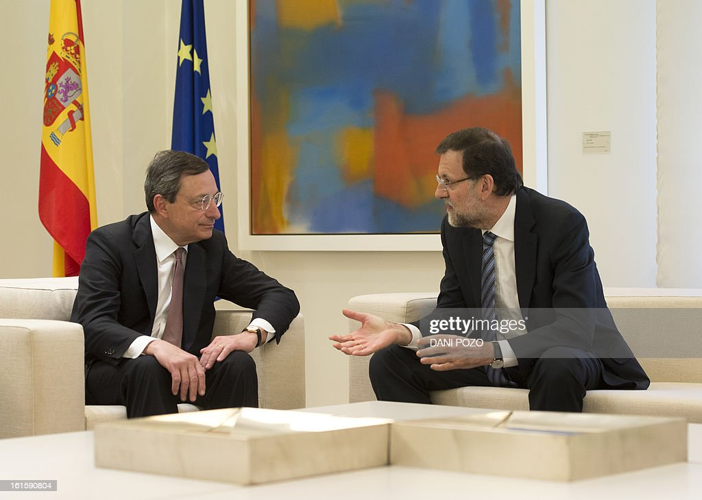 President of the ECB (European Central Bank) Mario Draghi (L) speaks with Spain's Prime Minister Mariano Rajoy during a meeting at La Moncloa Palace in Madrid on February 12, 2013. AFP PHOTO/ DANI POZO