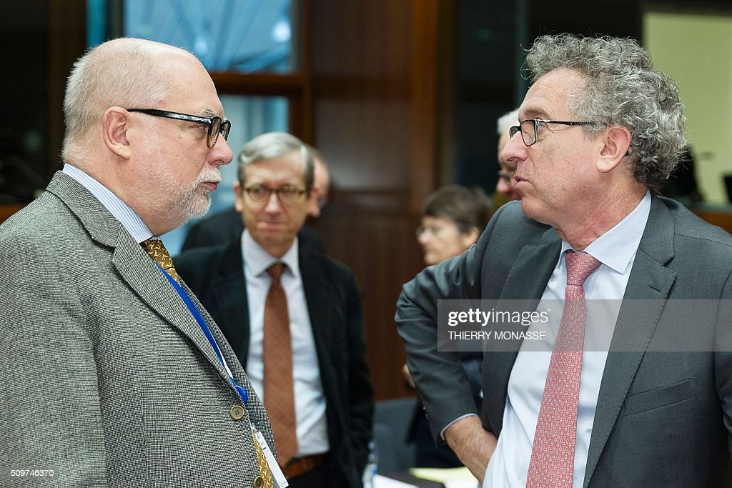 President of the Euro Working Group Thomas Wieser (L) talks with Luxembourg's Finance minister Pierre Gramegna prior to the start of the European Union Eco-Finance Council meeting at the EU Council building in Brussels on February 12, 2016. AFP PHOTO / THIERRY MONASSE / AFP / THIERRY MONASSE