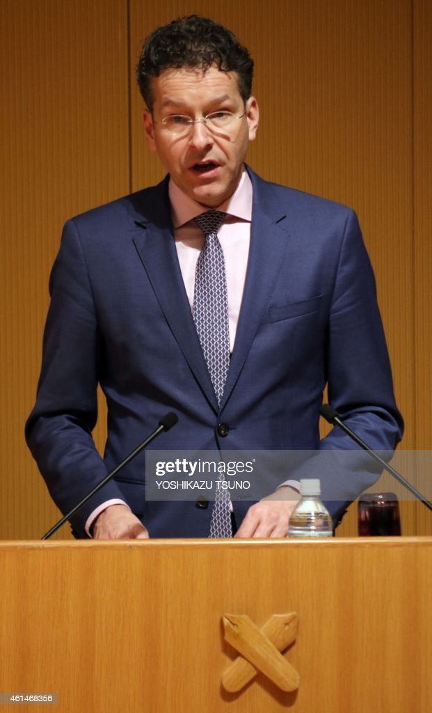 President of the Eurogroup, Dutch Finance Minister <a gi-track='captionPersonalityLinkClicked' href=/galleries/search?phrase=Jeroen+Dijsselbloem&family=editorial&specificpeople=9751962 ng-click='$event.stopPropagation()'>Jeroen Dijsselbloem</a>, delivers a speech on 'Growth in the Eurozone' at Japan's Keio University in Tokyo on January 13, 2015. The head of the group of eurozone finance ministers promised to work with the winner of the upcoming Greek election, but urged Athens to stick with austerity. AFP PHOTO / Yoshikazu TSUNO