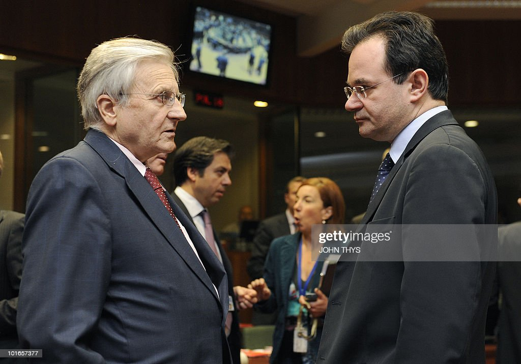 President of the European Central Bank Jean-Claude Trichet (L) talks with Greece's Finance Minister George Papaconstantinou (R) prior to an Economic and Financial Affairs Council (ECOFIN) on May 18, 2010 at the EU headquarters in Brussels. Europe's near trillion-dollar rescue fund for debt-laden eurozone countries has yet to be finalised, the eurozone's finance chief said.Ministers from the 16 countries that share the currency would meet for fresh talks Friday before the package could become operational, Luxembourg Prime Minister Jean-Claude Juncker said.