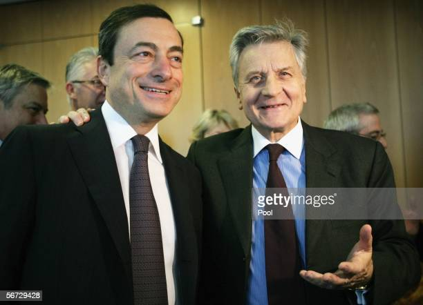 President of the European Central Bank JeanClaude Trichet talks with the new Governor of the Banca d'Italia Mario Draghi at the ECB Headquarters...