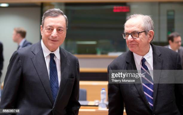 President of the European Central Bank Mario Draghi is talking with the Italian Minister Economy Finance Pier Carlo Padoan prior an Eurogroup where...