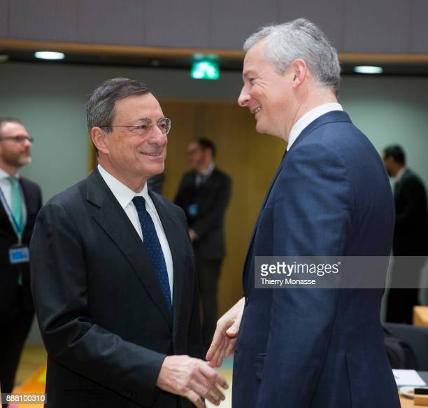 President of the European Central Bank Mario Draghi is talking with the French Minister of the Economy Bruno Le Maire prior an Eurogroup where the...