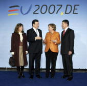 President of the European Commision Jose Manuel Barroso and his wife Margarida speak with German Chancellor and current President of the European...