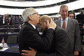 President of the European Commission JeanClaude Juncker and President of the European Parliament Martin Schulz greet one another in the plenary room...