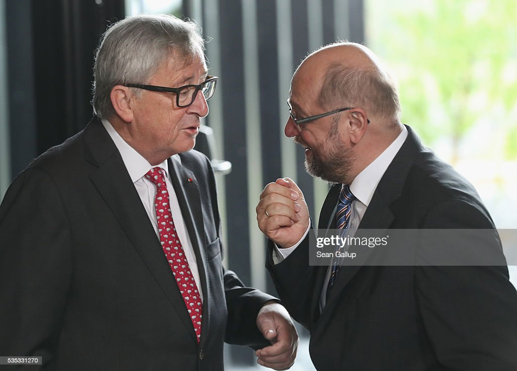 President of the European Commission <a gi-track='captionPersonalityLinkClicked' href=/galleries/search?phrase=Jean-Claude+Juncker&family=editorial&specificpeople=207032 ng-click='$event.stopPropagation()'>Jean-Claude Juncker</a> (L) chats with President of the European Parliament <a gi-track='captionPersonalityLinkClicked' href=/galleries/search?phrase=Martin+Schulz&family=editorial&specificpeople=598638 ng-click='$event.stopPropagation()'>Martin Schulz</a> at the inauguration of the Verdun Memorial during ceremonies to commemorate the 100th anniversary of the World War I Battle of Verdun on May 29, 2016 near Verdun, France. The 1916, 10-month battle pitted the French and German armies against one another in a grueling campaign of trench warfare and artillery bombardments that killed a total of approximately 300,000 soldiers. The events today coincide with the 50th anniversary of commemorations held at Verdun by then French President Charles de Gaulle and German Chancellor Konrad Adenauer that paved the way for a new era of peaceful, post-war Franco-German relations.