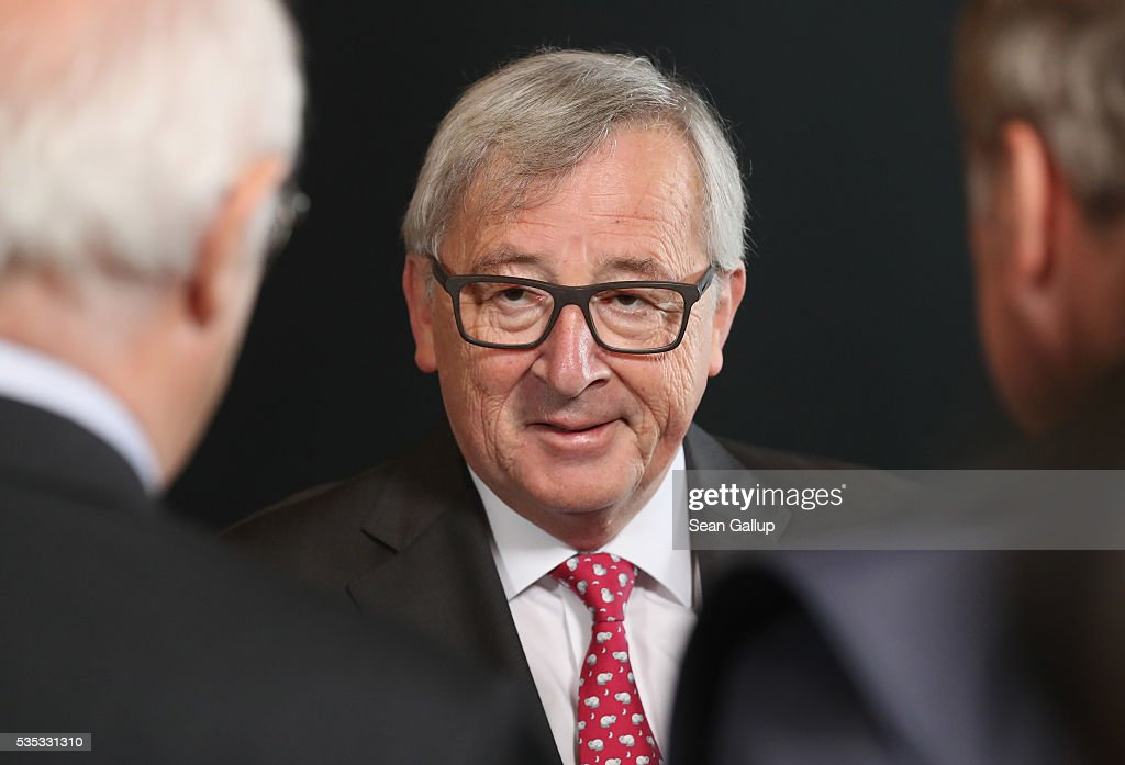 President of the European Commission <a gi-track='captionPersonalityLinkClicked' href=/galleries/search?phrase=Jean-Claude+Juncker&family=editorial&specificpeople=207032 ng-click='$event.stopPropagation()'>Jean-Claude Juncker</a> (C) chats with guests at the inauguration of the Verdun Memorial during ceremonies to commemorate the 100th anniversary of the World War I Battle of Verdun on May 29, 2016 near Verdun, France. The 1916, 10-month battle pitted the French and German armies against one another in a grueling campaign of trench warfare and artillery bombardments that killed a total of approximately 300,000 soldiers. The events today coincide with the 50th anniversary of commemorations held at Verdun by then French President Charles de Gaulle and German Chancellor Konrad Adenauer that paved the way for a new era of peaceful, post-war Franco-German relations.