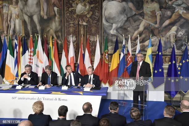 President of the European Commission JeanClaude Juncker delivers a speech next to President of the European Commission JeanClaude Juncker EU...