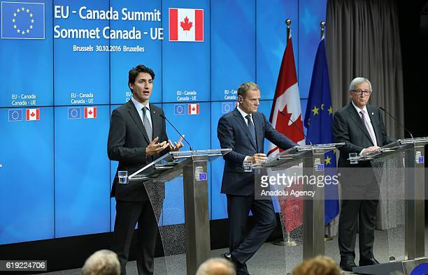 President of the European Commission JeanClaude Juncker EU Council President Donald Tusk and Canadian Prime Minister Justin Trudeau hold a joint...