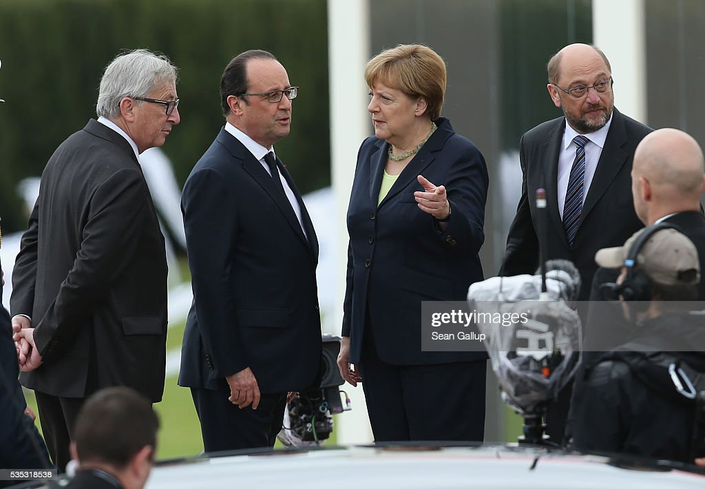 President of the European Commission <a gi-track='captionPersonalityLinkClicked' href=/galleries/search?phrase=Jean-Claude+Juncker&family=editorial&specificpeople=207032 ng-click='$event.stopPropagation()'>Jean-Claude Juncker</a>, French President Francois Hollande, German Chancellor <a gi-track='captionPersonalityLinkClicked' href=/galleries/search?phrase=Angela+Merkel&family=editorial&specificpeople=202161 ng-click='$event.stopPropagation()'>Angela Merkel</a> and President of the European Parliament <a gi-track='captionPersonalityLinkClicked' href=/galleries/search?phrase=Martin+Schulz&family=editorial&specificpeople=598638 ng-click='$event.stopPropagation()'>Martin Schulz</a> attend ceremonies to commemorate the 100th anniversary of the World War I Battle of Verdun at the Douaumont cemetery on May 29, 2016 near Verdun, France. The 1916, 10-month battle pitted the French and German armies against one another in a grueling campaign of trench warfare and artillery bombardments that killed a total of approximately 300,000 soldiers. The events today coincide with the 50th anniversary of commemorations held at Verdun by then French President Charles de Gaulle and German Chancellor Konrad Adenauer that paved the way for a new era of peaceful, post-war Franco-German relations.