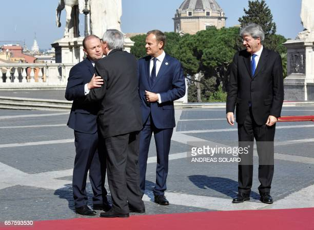 President of the European Commission JeanClaude Juncker is greeted by Italy's Prime Minister Paolo Gentiloni European Council President Donald Tusk...