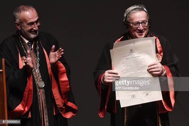 President of the European Commission JeanClaude Juncker poses after receiving an honorary doctorate award by the Aristotle University of Thessaloniki...