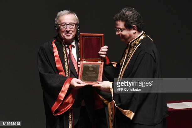 President of the European Commission JeanClaude Juncker poses as he receives an honorary doctorate award by the Aristotle University of Thessaloniki...