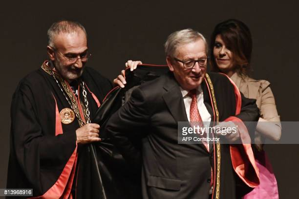 President of the European Commission JeanClaude Juncker puts on a toga as he receives an honorary doctorate award by the Aristotle University of...