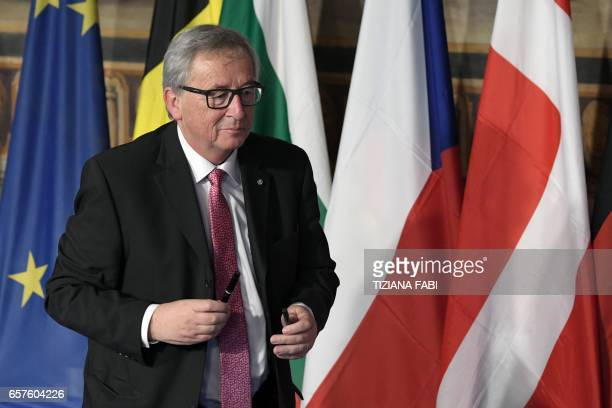 President of the European Commission JeanClaude Juncker stands up after signing the new Rome declaration with leaders of 27 European Union countries...