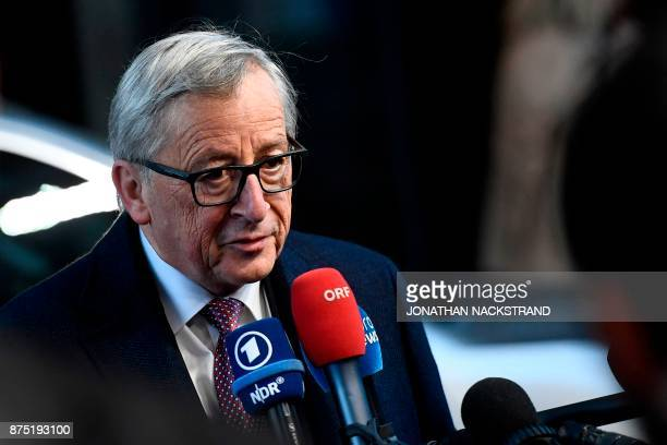 President of the European Commission JeanClaude Juncker talks to journalists as he arrives to attend the European Social Summit in Gothenburg Sweden...