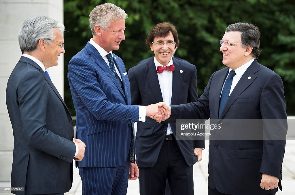 President of the European Commission Jose Manuel Barroso (R) and Belgian Defense Minister Pieter De Crem shake hands during a WW1 100 Years Commemoration Ceremony at Le Memorial Interallie on August 4, 2014 in Liege, Belgium.