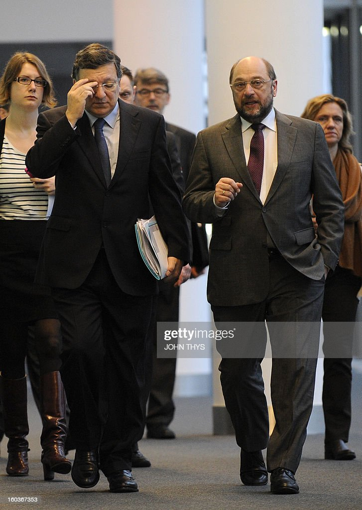 President of the European Commission Jose Manuel Barroso (L) and European Parliament President Martin Schulz arrive before the 'European Parliamentary Week on the European Semester' on economic policy coordination at the European Parliamen in Brussels on January 30, 2013.
