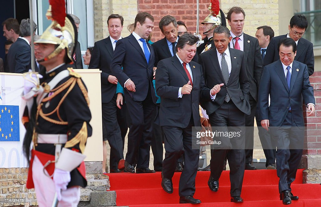 President of the European Commission Jose Manuel Barroso chats with US President Barack Obama as British Prime Minister David Cameron Russian...