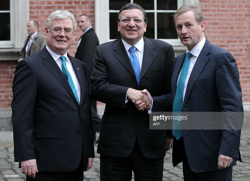 President of the European Commission Jose Manuel Barroso (C) is greeted by Irish Prime Minister Enda Kenny (R) and Deputy Prime Minister Eamon Guilmore (L) as he arrives for a meeting between the Irish Government and Members of the College of Commissioners at Dublin Castle in Dublin on January 10, 2013 as Ireland began its six-month presidency of the European Union.