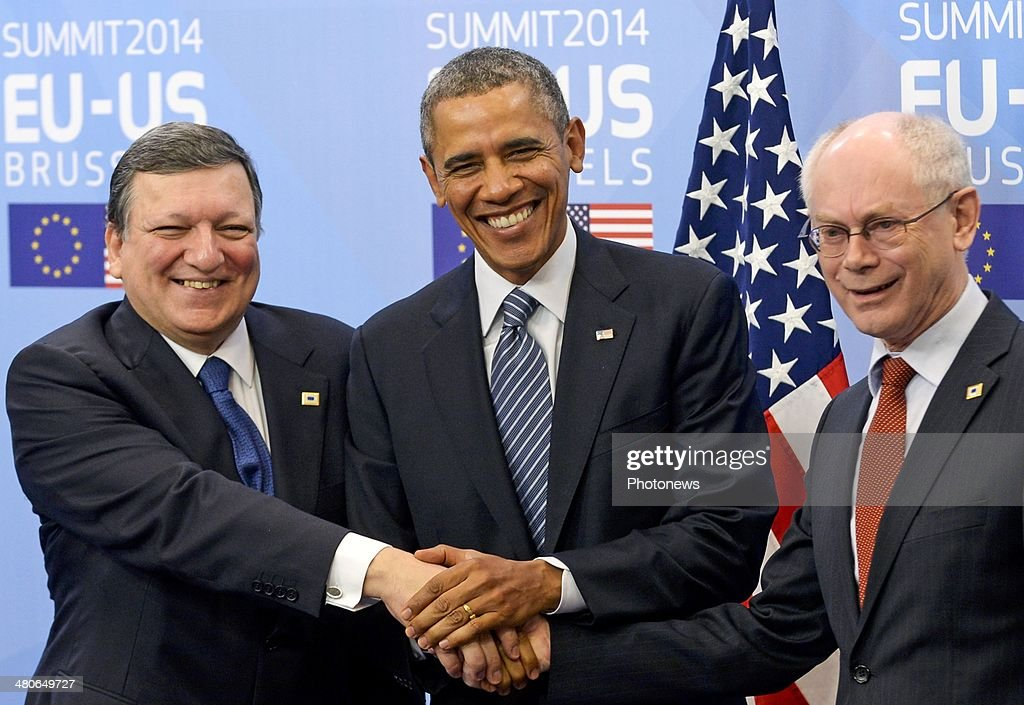 President of the European Commission Jose-Manuel Barroso, President of the United States <a gi-track='captionPersonalityLinkClicked' href=/galleries/search?phrase=Barack+Obama&family=editorial&specificpeople=203260 ng-click='$event.stopPropagation()'>Barack Obama</a> and President of the European Council Herman van Rompuy shake hands at the European Summit on March 26, 2014 in Brussels, Belgium. The US President met with the European Union's top officials to discuss energy resources, climate change and the situatuion in Ukraine.