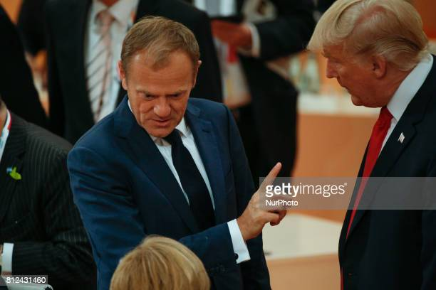 President of the European Council Donald Tusk is seen speaking to US president Donald Trump and German chancelllor Angela Merkel ahead of the thrid...