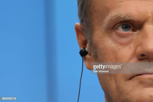 President of the European Council Donald Tusk listens during a press conference after a European Council Meeting at the Council of the European Union...