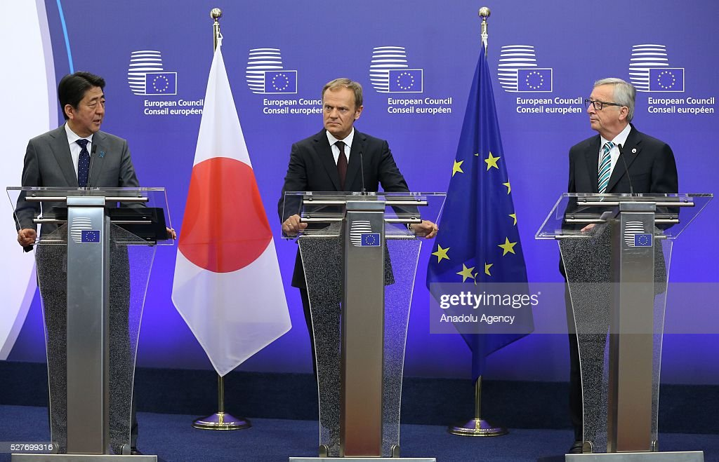 President of the European Council Donald Tusk (C), President of the European Commission Jean-Claude Juncker (R) and Japanese Prime Minister Shinzo Abe hold a joint press conference after the EU - Japan leaders' meeting at the EU headquarters in Brussels on May 3, 2016.