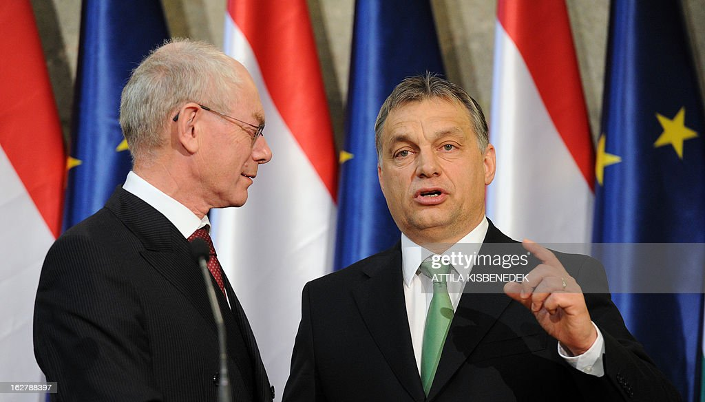 President of the European Council Herman van Rompuy (L) and his host Hungarian Prime Minister Viktor Orban (R) give a joint press conference at the delegation hall of the parliament building in Budapest on February 27, 2013. Van Rompuy is on a one-day working visit to Hungary. AFP PHOTO / ATTILA KISBENEDEK