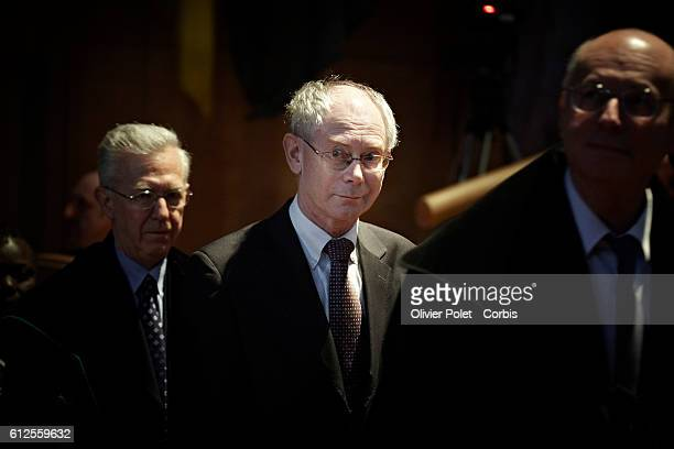 President of the European Council Herman Van Rompuy seen with his assistants before he receives the 'Doctorat honoris causa' award | Location...