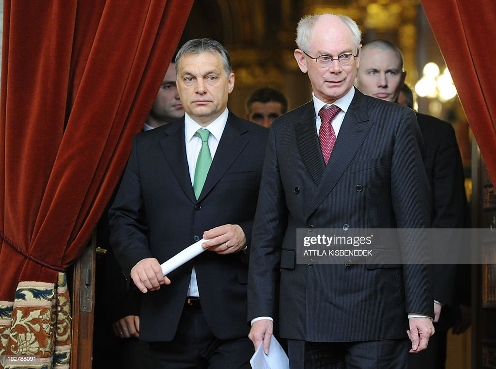 President of the European Council Herman van Rompuy (R) steps into the delegation hall of the parliament building with his host Hungarian Prime Minister Viktor Orban (L) in Budapest on February 27, 2013 prior to their joint press conference. Van Rompuy is on a one-day working visit to Hungary.