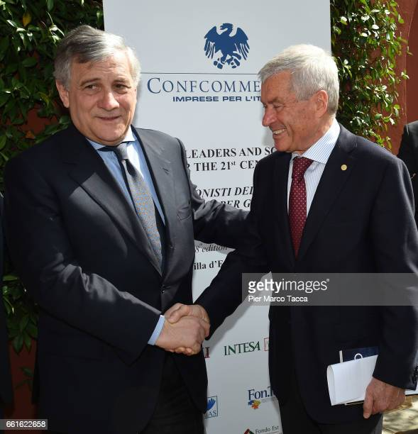 President of the European Parliament Antonio Tajani shakes hands with President of Confcommercio Carlo Sangalli during the Confcommercio Forum at...