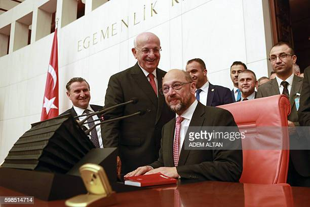 President of the European Parliament Martin Schulz seats next to Speaker of the Turkish Grand National Assembly Ismail Kahraman during his visit of...