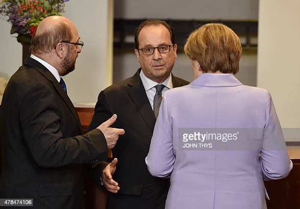 President of the European Parliament Martin Schulz talks with French President Francois Hollande and German Chancellor Angela Merkel after a family...