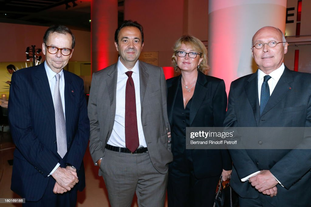 President of the event Louis Schweitzer (1st L) Claude Chirac (2nd R) with Husband Frederic Salat-Baroux (2nd L) and CEO of Quai Branly Museum Stephane Martin (1st R) attend 'Friends of Quai Branly Museum Society' dinner party at Musee du Quai Branly on September 9, 2013 in Paris, France.