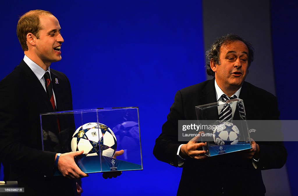 President of The FA Prince William, Duke of Cambridge is presented a match ball by UEFA President Michel Platini during the UEFA Congress at the Grovesnor House Hotel on May 24, 2013 in London, United Kingdom. The UEFA Champions League Final between Borussia Dortmund and Bayern Munich kicks off tomorrow at Wembley Stadium, London.