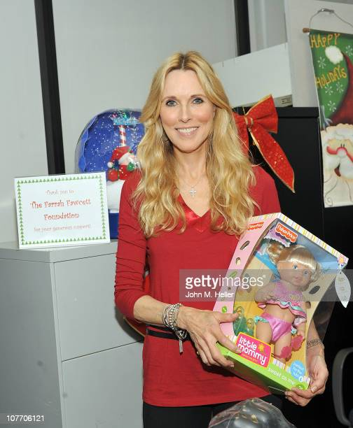 President of the Farrah Fawcett Foundation actress/author Alana Stewart hands out toys to the children of the outpatient oncology unit at the Farrah...