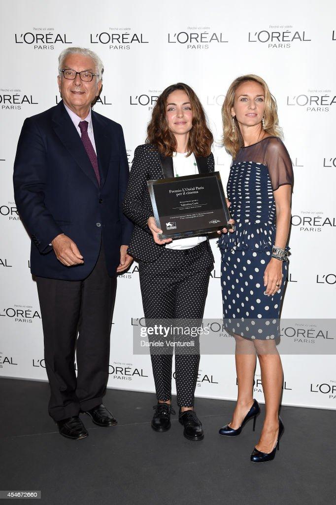 President of the Festival Paolo Baratta and brand director of L'Oreal Paris Italia Stefania Fabiano pose with winner Valentina Corti at the 'L'Oreal...