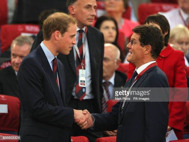 President of the Football Association Prince William shakes hands with England manager Fabio Capello before the UEFA Champions League Final at the...