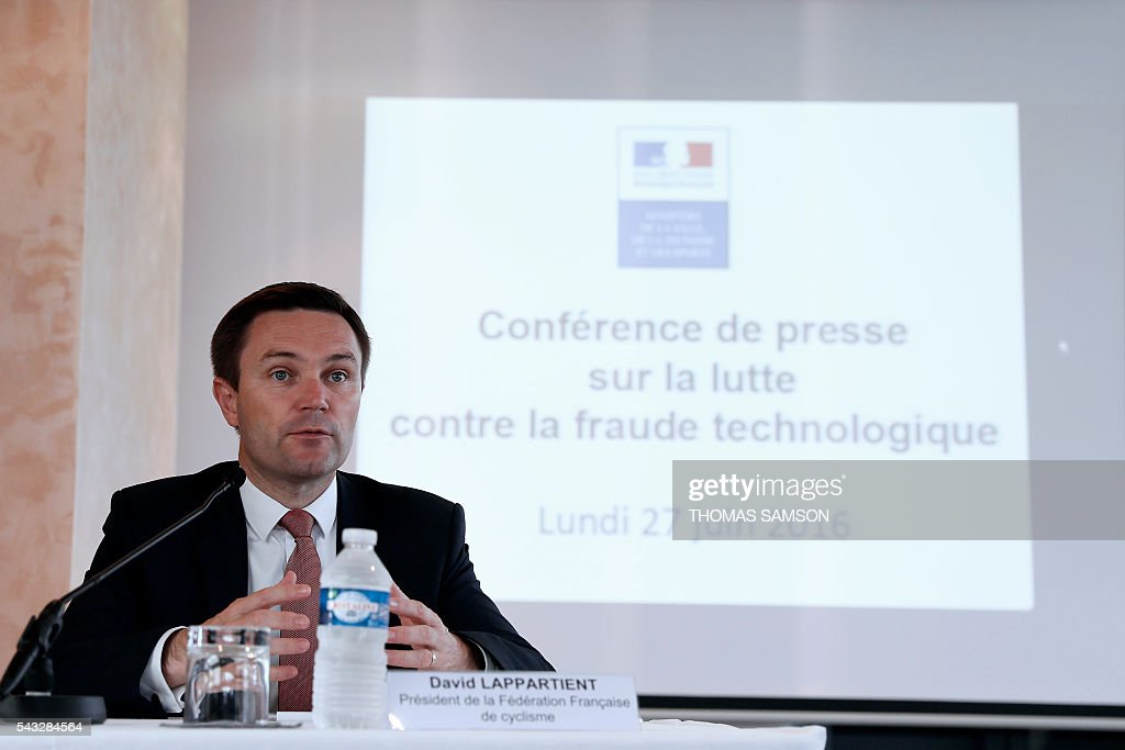President of the French cycling federation David Lappartient speaks during a press conference on mechanical fraud, in Paris, on June 27, 2016. Thermal cameras will be used in this year's Tour de France to fight against motor cheats, French Minister of State for Sport Thierry Braillard announced on Monday. The cameras, which can detect a motor in a bicycle, have been developed by the Atomic Energy Commission (CEA) at the request of the French government. / AFP / Thomas SAMSON