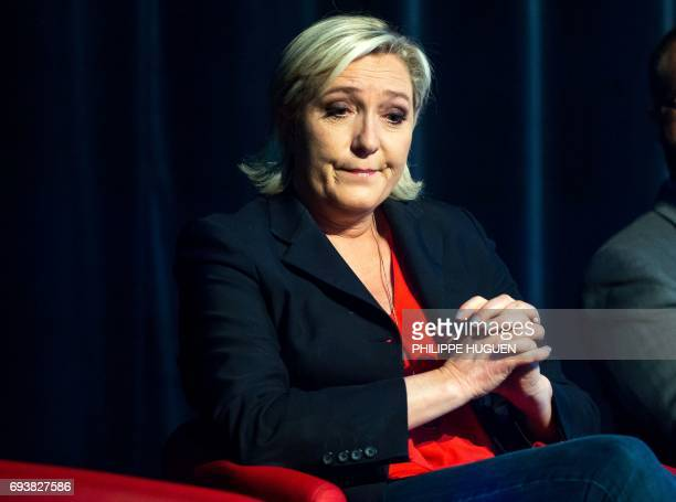 President of the French farright Front National party Marine Le Pen reacts during a campaign rally on June 8 2017 in Calais in support of the local...