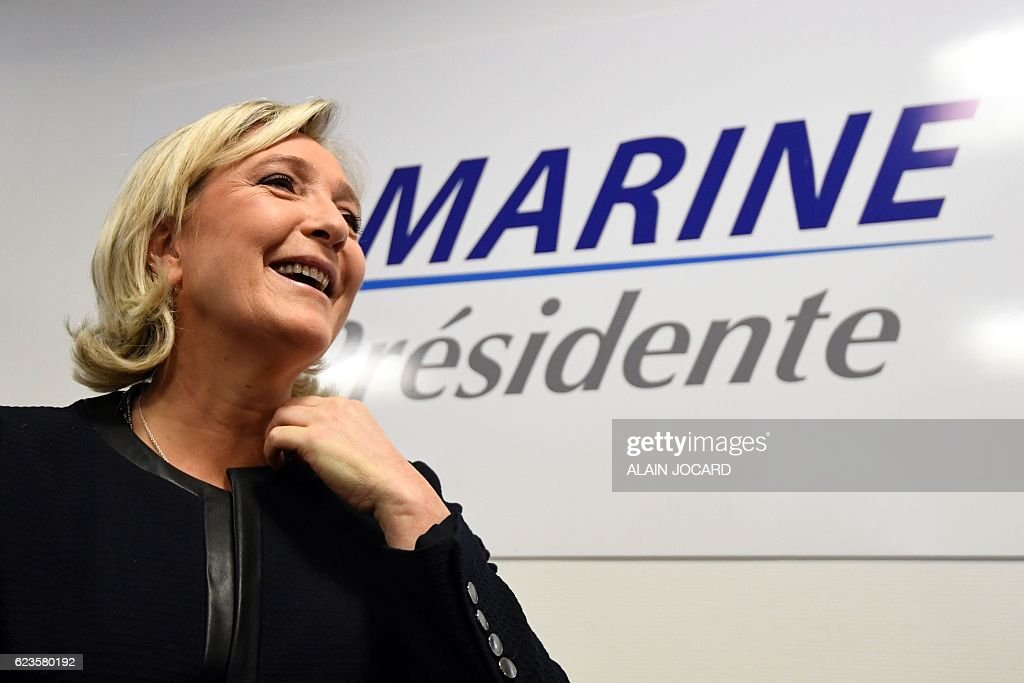 President of the French far-right party and presidential candidate for the 2017 French presidential elections Marine Le Pen smiles during the inauguration of her campaign headquarters in Paris on November 16, 2016. / AFP / ALAIN