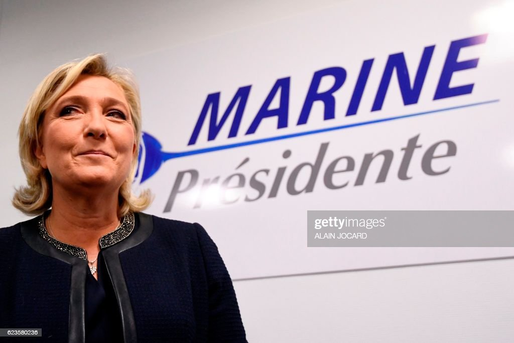 President of the French far-right party and presidential candidate for the 2017 French presidential elections Marine Le Pen looks on during the inauguration of her campaign headquarters in Paris on November 16, 2016. / AFP / ALAIN