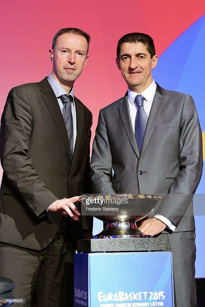President of the French Federation of basketball Jean Pierre Siutat and French team head coach Vincent Collet assist with the Euro basket 2015 draw...