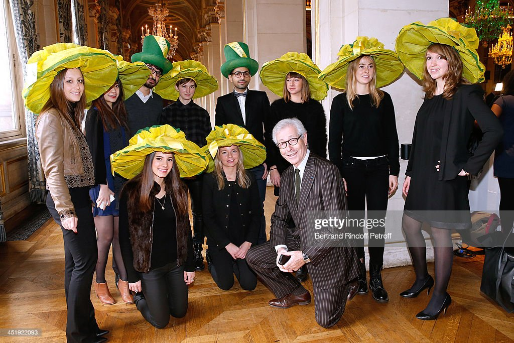 President of the French Federation of couture and ready-to-wear, Didier Grumbach (C) with Nicolas and Catherinettes from Givenchy attend Sainte-Catherine Celebration at Mairie de Paris on November 25, 2013 in Paris, France.