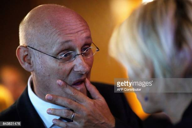 President of the French Federation of Rugby Bernard Laporte reacts during a press conference promoting France's candidacy for the 2023 Rugby World...