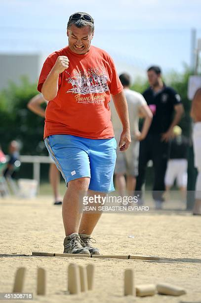 President of the French Molkky Federation Fabien Schomann reacts during a Molkky game on June 21 2014 in L'Hermitage western France The Molkky is a...
