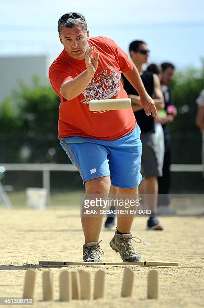 President of the French Molkky Federation Fabien Schomann throws a skittle while playing Molkky on June 21 2014 in L'Hermitage western France The...