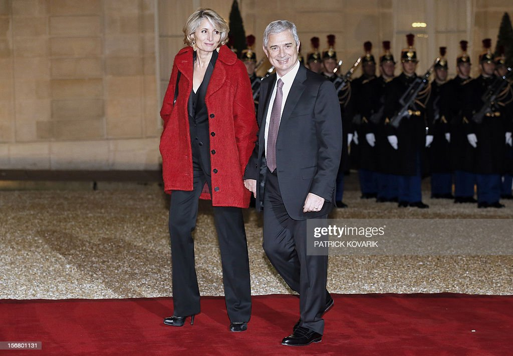President of the French National Assembly, Claude Bartolone and his wife Veronique arrive, at the Elysee palace in Paris, before a state dinner as part of a two-day state visit of Italian President Giorgio Napolitano, on November 21, 2012.