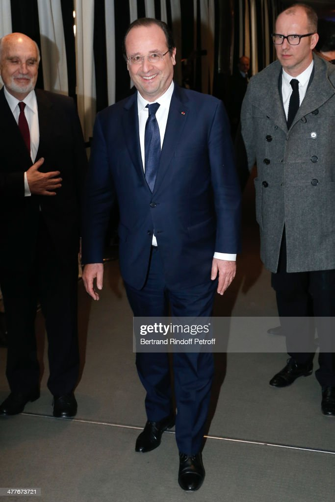 President of the French Republic Francois Hollande attends the 'Aimer, Boire Et Chanter' Paris movie premiere. Held at Cinema UGC Normandie on March 10, 2014 in Paris, France.